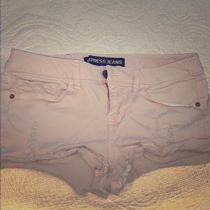 Ripped pink shorts